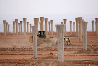 Workers build a thermosolar power plant at Noor II near the city of Ouarzazate, Morocco, November 4, 2016. (Credit: Reuters/Youssef Boudlal) Click to Enlarge.