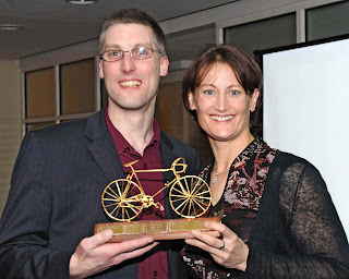 Receiving Peter's Golden Bicycle from Anne Dickins