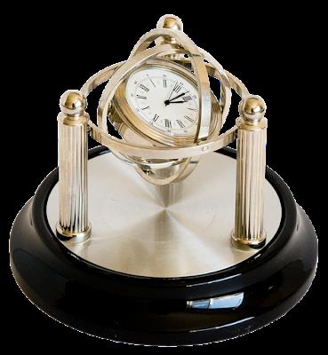 A fancy desk clock styled like a gyroscope.