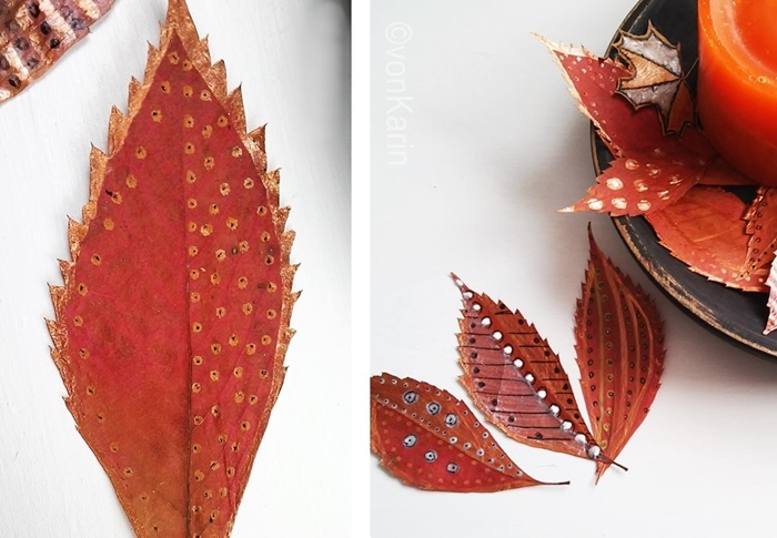 Gepresste bunte Herbstblaetter bemalt mit Mustern