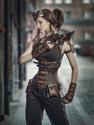 An example of an Underbust corset used in women's Steampunk fashion. This woman wears her underbust corset with pants, a tank top, armored epaulets, a belt, goggles, gloves and a gun.
