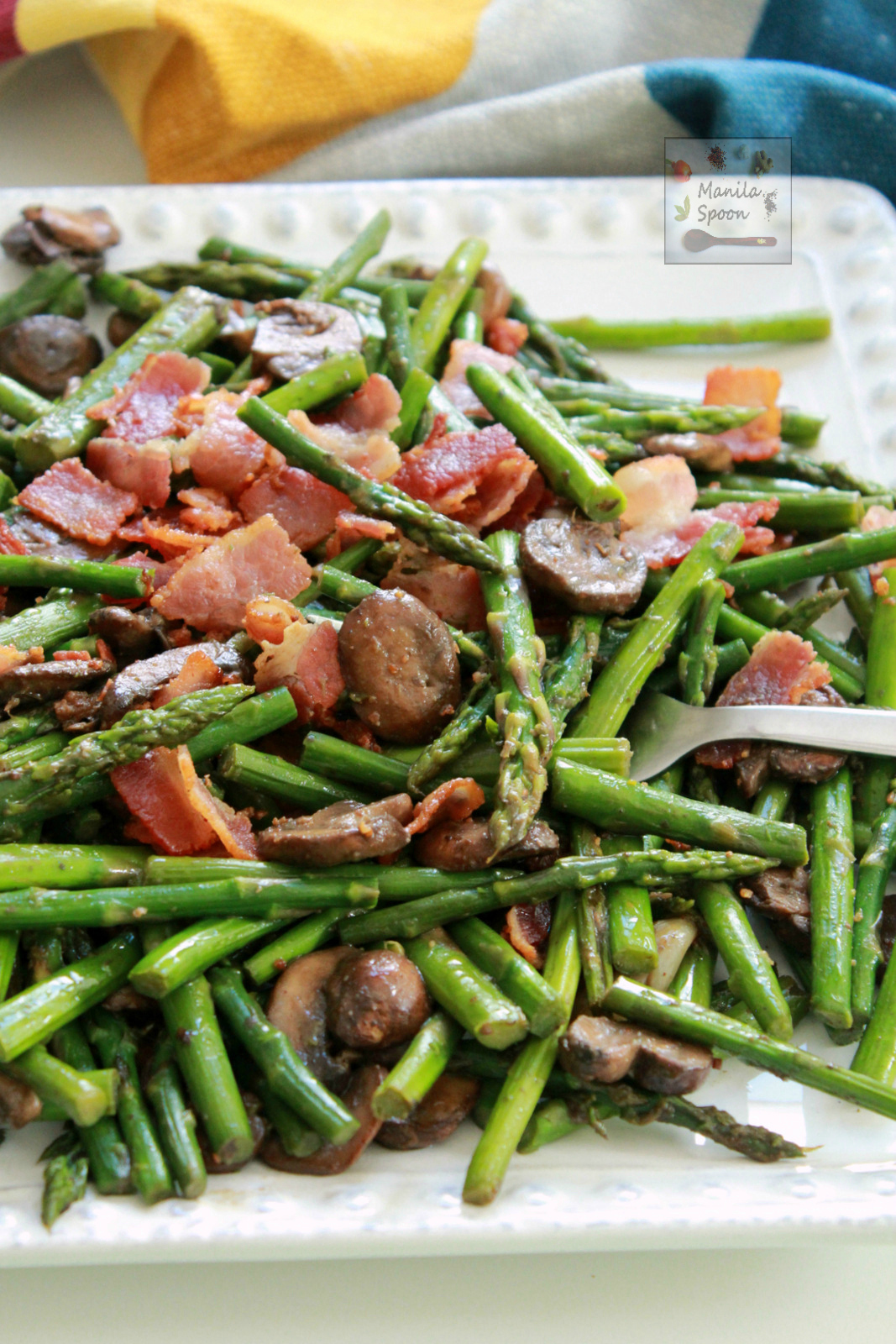 This quick and easy Asparagus dish is loaded with flavor from bacon and mushrooms! Done in 15 minutes or less. Totally gluten-free and low-carb, too.