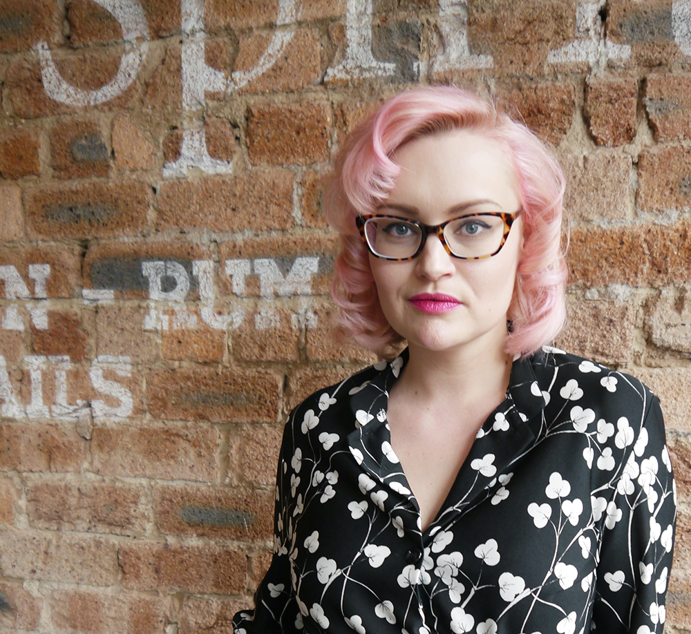 Pin up style with pink pincurls and vintage style glasses from IOLLA