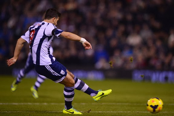 West Brom striker Shane Long shoots to score his first goal against Aston Villa