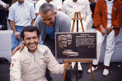 Lee Petty (right) and son Richard Petty.