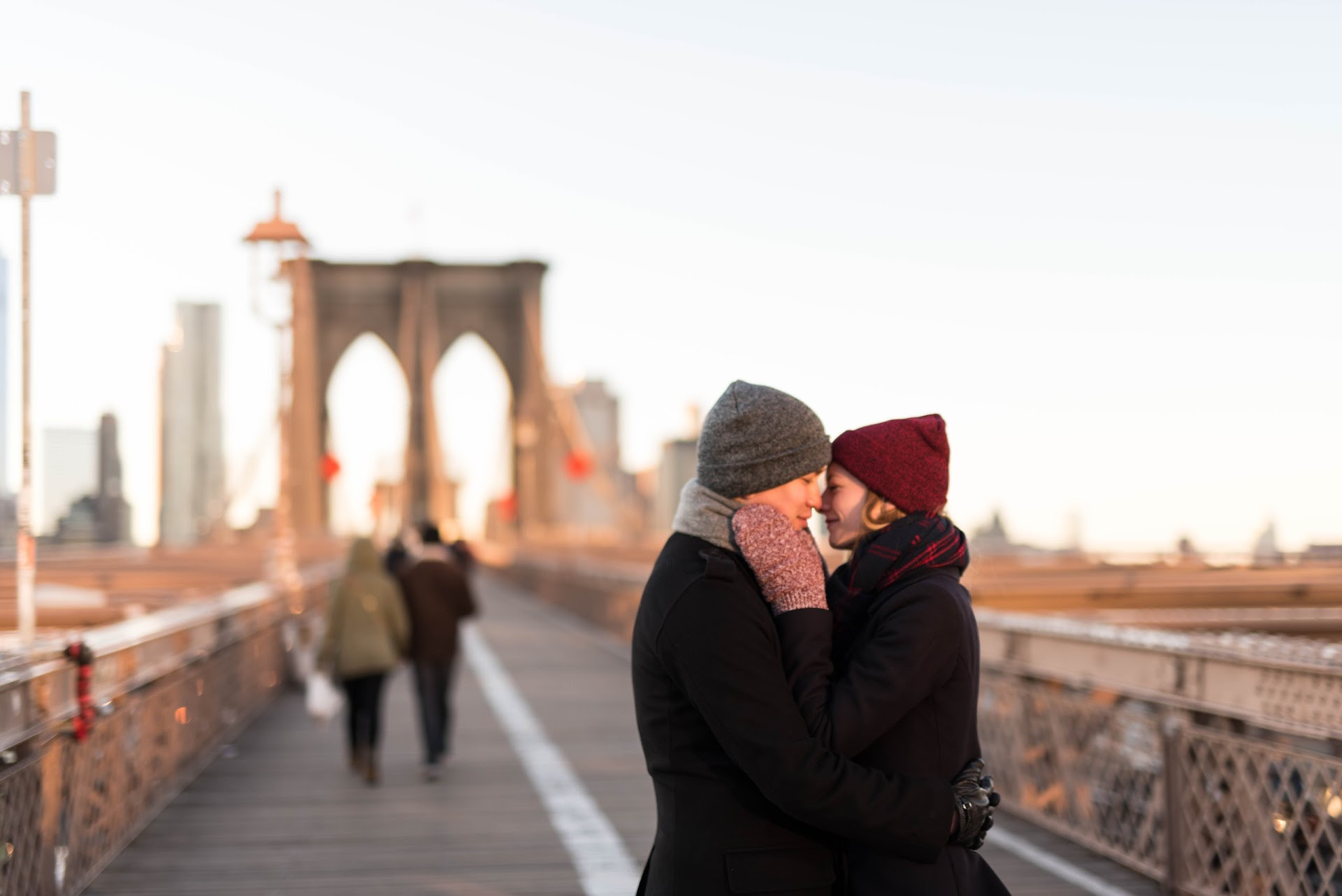 brooklyn bridge, engagements, couple, photography, bridge, winter, nyc, new york, manhattan architecture, skyline, winter engagement photo outfits, poses, ideas