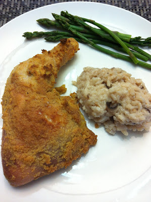 Hummus (humus) crusted chicken baked in the oven along side risotto and asparagus