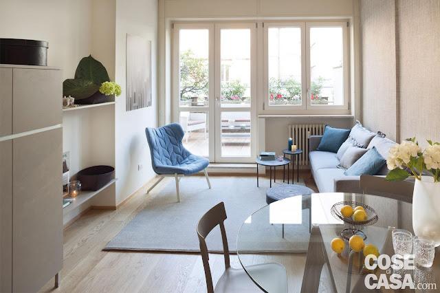 Plan deschis și accente de albastru în amenajarea unui apartament de 37 m²