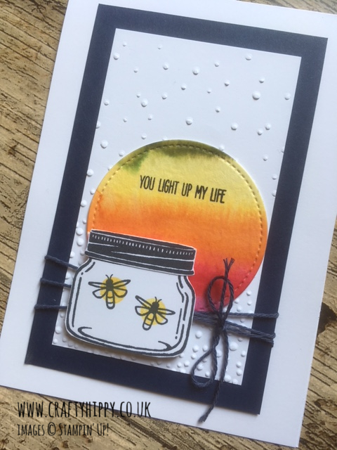 Handmade card featuring a jar with fireflies, a Softly Falling embossed background, and Night of Navy Cardstock border, made with the Jar of Love stamp set by Stampin' Up!