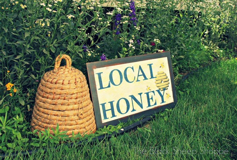 Local Honey sign in wildflower garden.