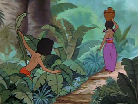 Mowgli espía a la joven de la aldea en El libro de la selva - Cine de Escritor