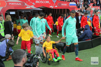 Ronaldo makes history,walks with disabled girl onto field