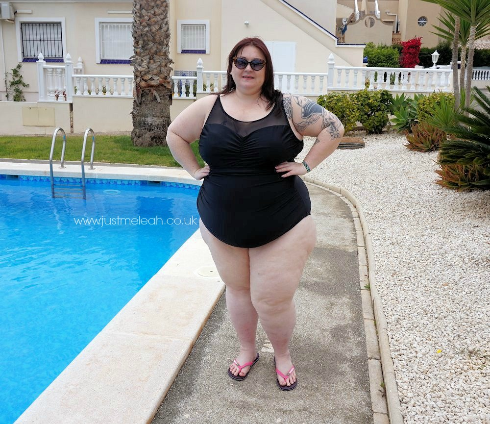 Black-mesh-swimsuit. Black-and-white-striped-sarong-by-Yours-Clothing. Plus-size-swimwear. Plus-size-beachwear