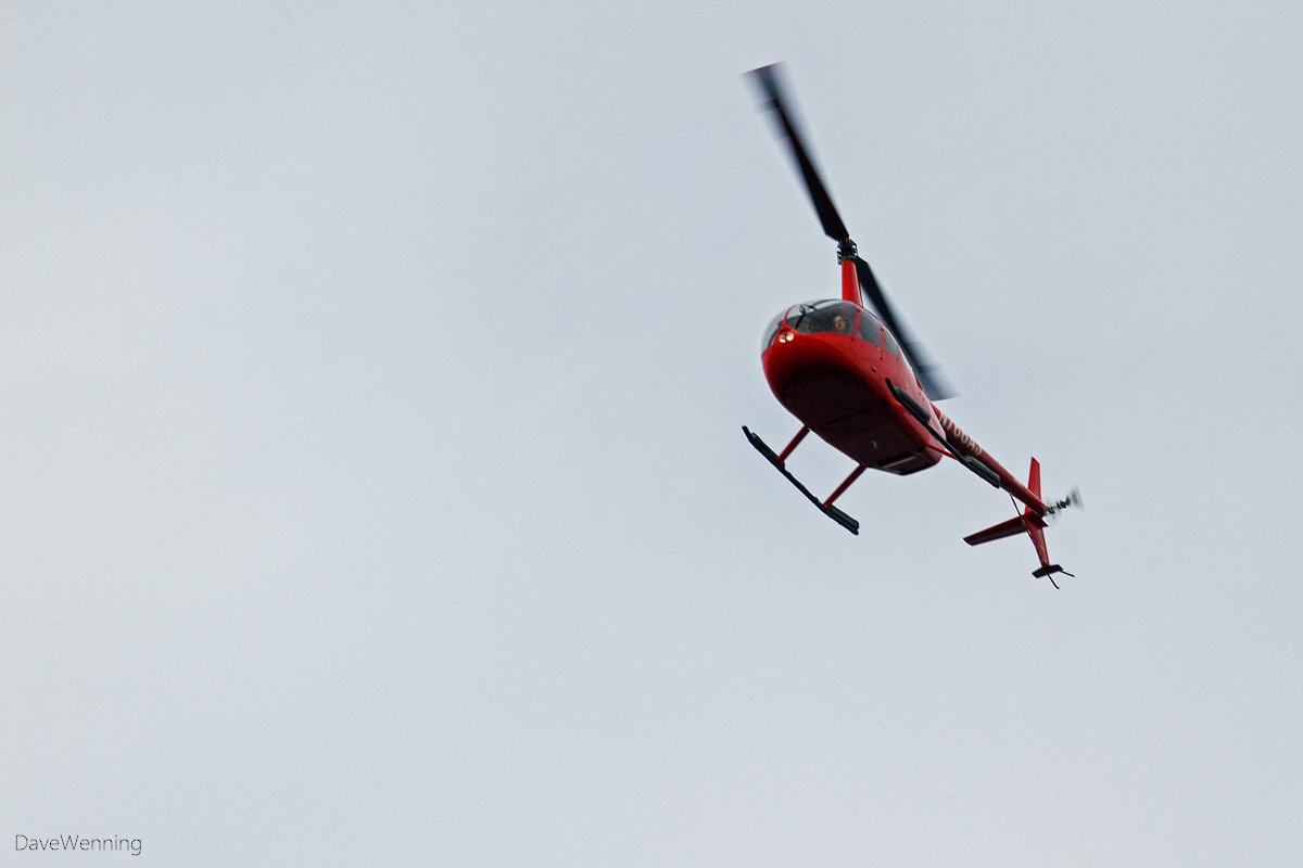 A Red Helicopter Passes Over