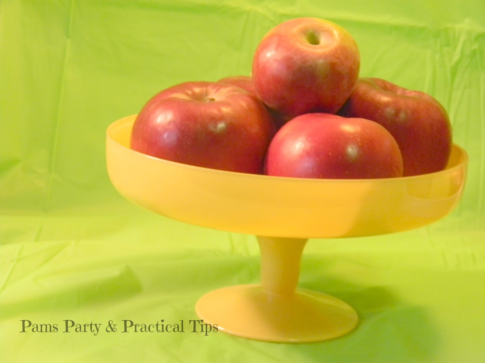 A cake plate used as an apple display bowl
