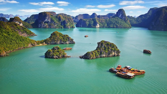 What should you visit when travelling in Halong Bay?