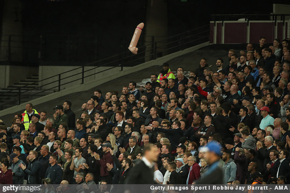 Fans throw around an inflatable dildo during the Premier League match between West Ham and Huddersfield
