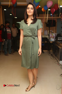 Actress Raashi Khanna Stills in Green Short Dress at Mirchi 95 Suno Aur Mercedes Jeeto Contest  0163.JPG