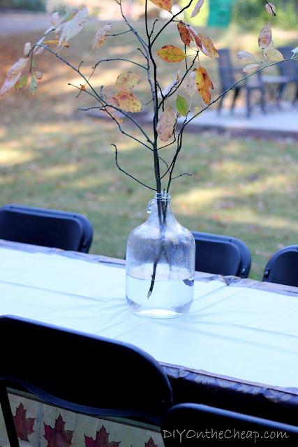 Old milk jug + tree branches = pretty Fall centerpiece