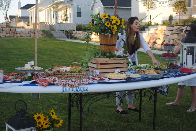 Stand up paddle board buffet table, summer party by the lake