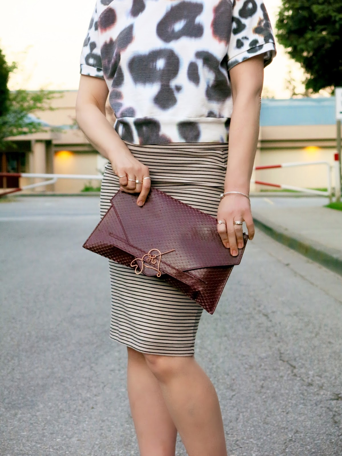 striped pencil skirt, cropped sweatshirt, envelope clutch