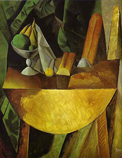 Bread and Fruit Dish on a table by Pablo Picasso