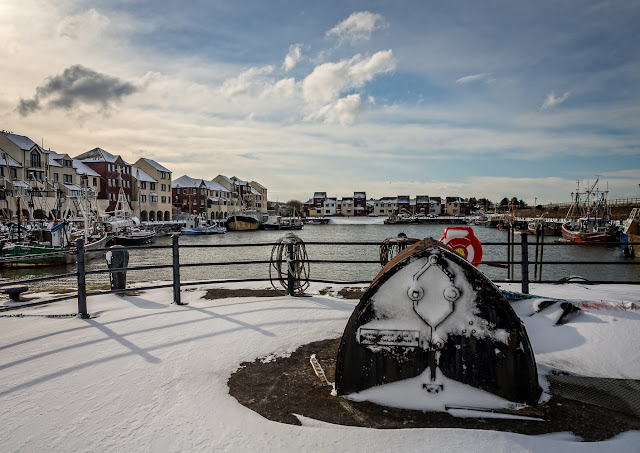Photo of sunshine and snow at Maryport harbour