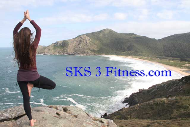 Yoga Girl is doing Vrikshasana Steps on cliff near sea