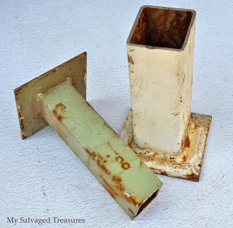repurposed rusty industrial footings