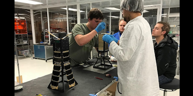 CXBN-2 Integration Team in the Morehead State University Spacecraft Integration and Assembly Facility.  Left to right:  Yevgeniy Byleborodov, Dr. Ben Malphrus, Michael Glaser-Garbrick and Nate Richard. Photo Credit: MSU