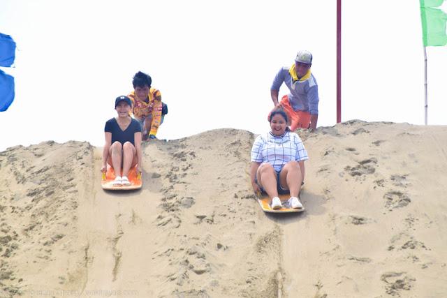 Sliding down the sand dues of Ilocos Norte