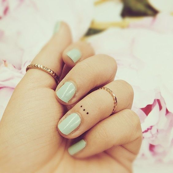 Small Symbolic Tattoos on Finger