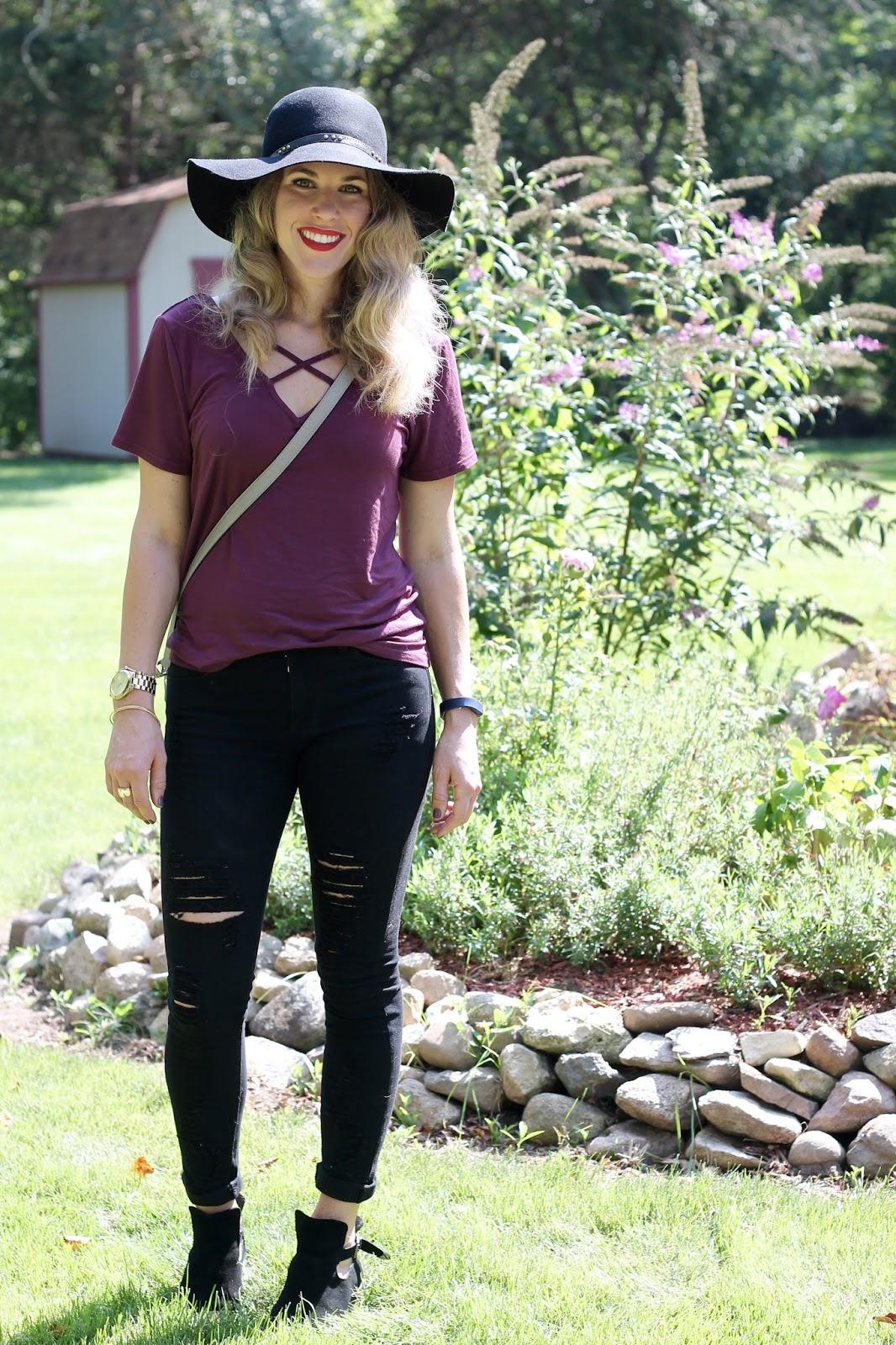 burgundy criss cross top, distressed black jeans, black booties, black floppy hat, grey saddlebag