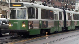 Green Line train derails, rain floods communities