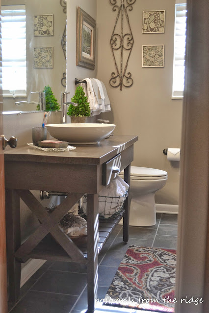 Benjamin Moore Plymouth Rock painted bathroom.  #plymouthrock #valleyforgetan #darktilefloors #vesselsink #openvanity