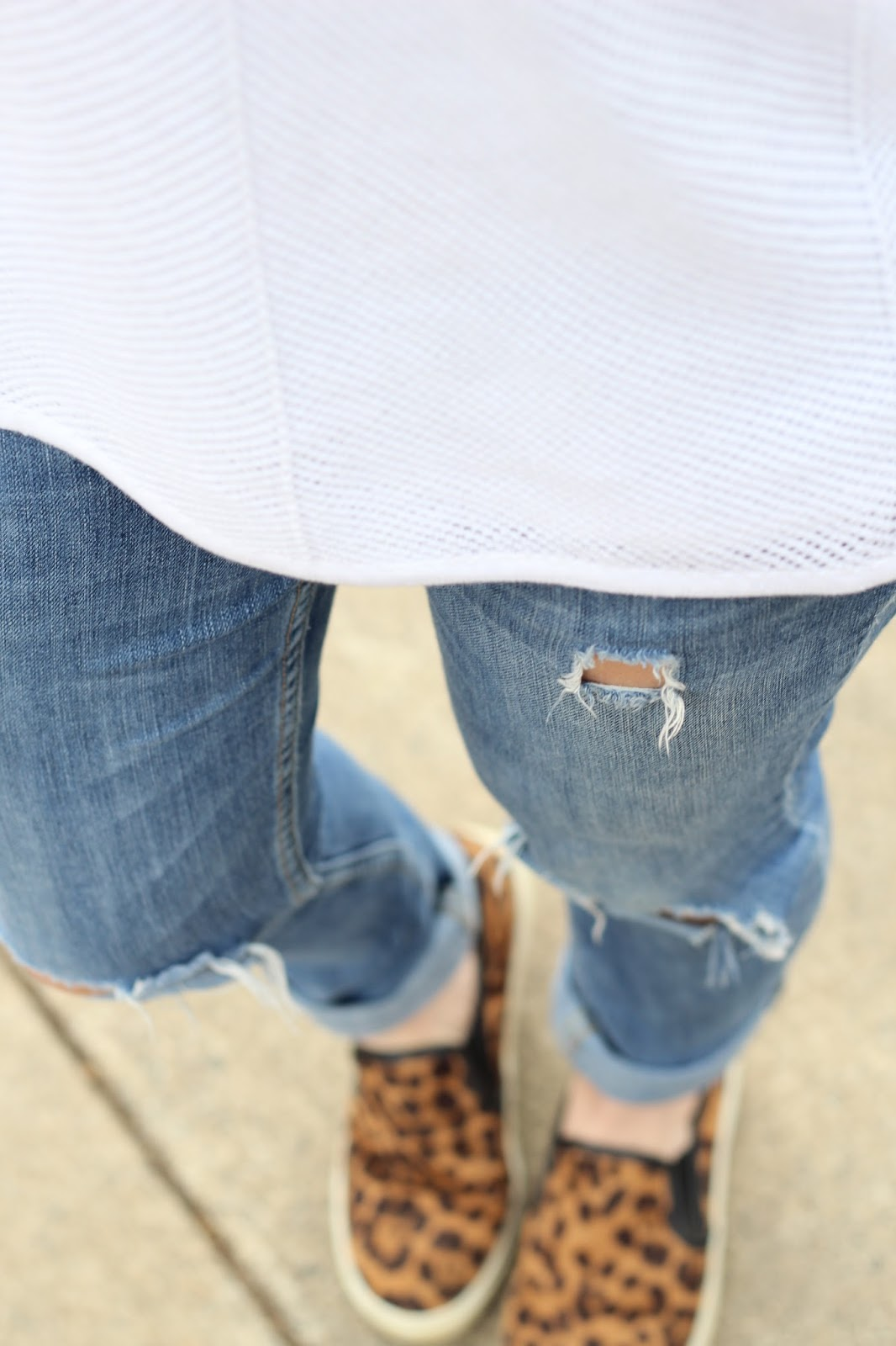 Distressed skinny jeans, leopard flats