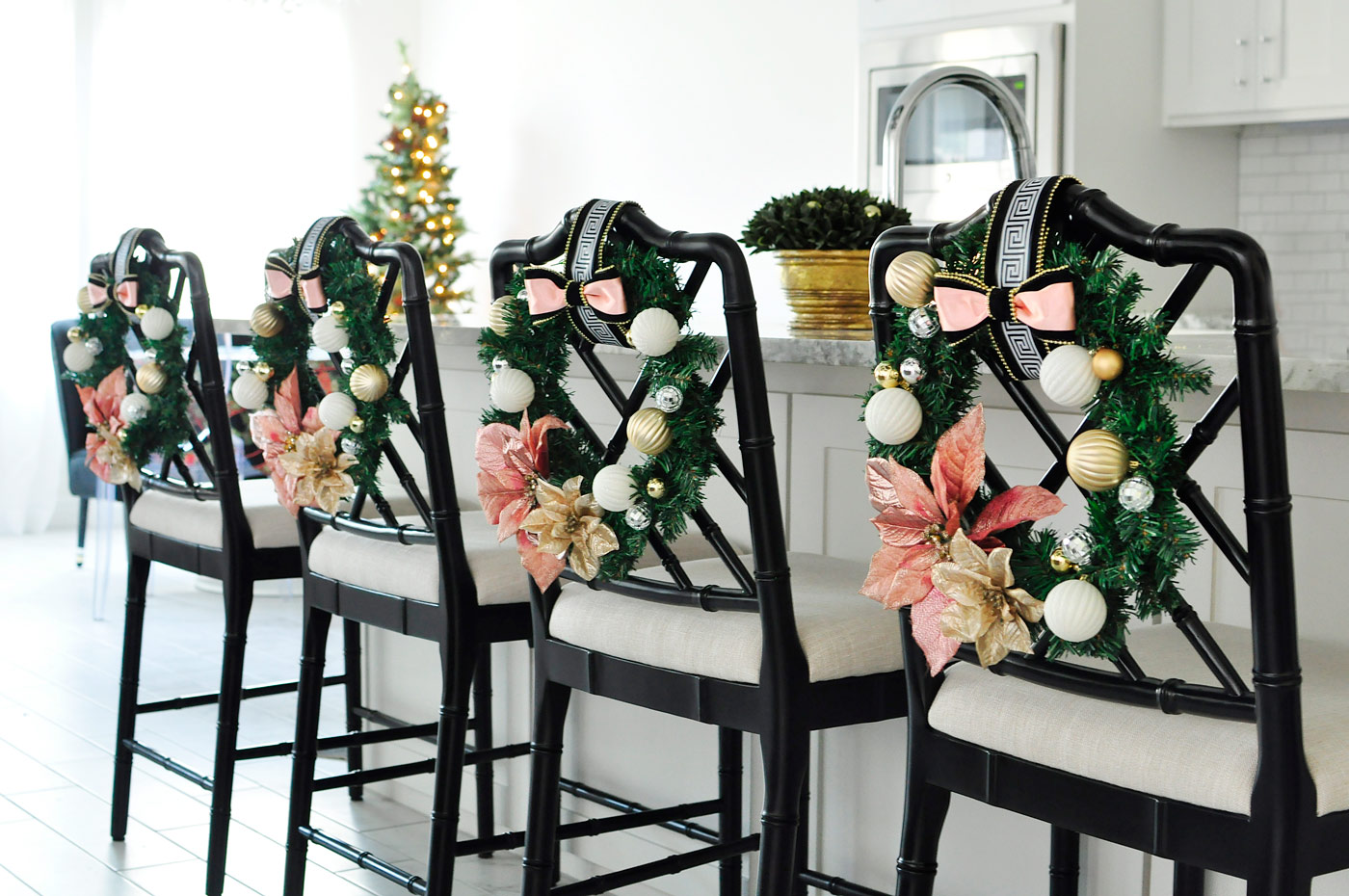 Holiday wreaths on the back of Dayna counter stools- the blush, white and gold with greek key accents are gorgeous and classy! | via monicawantsit.com