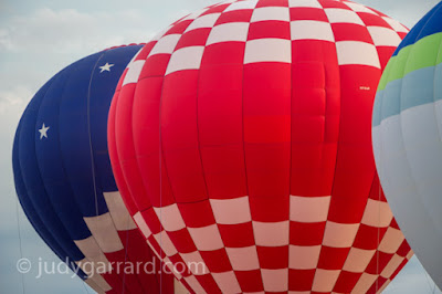 Three hot air balloons over Fayette