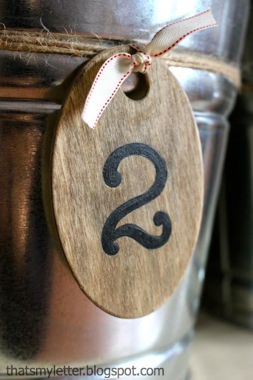 wood label tag on steel buckets