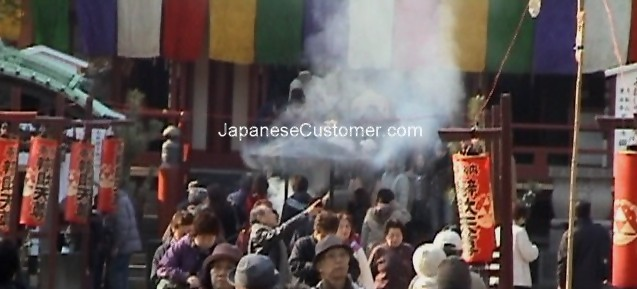Japanese customers visit a temple Copyright Peter Hanami 2014