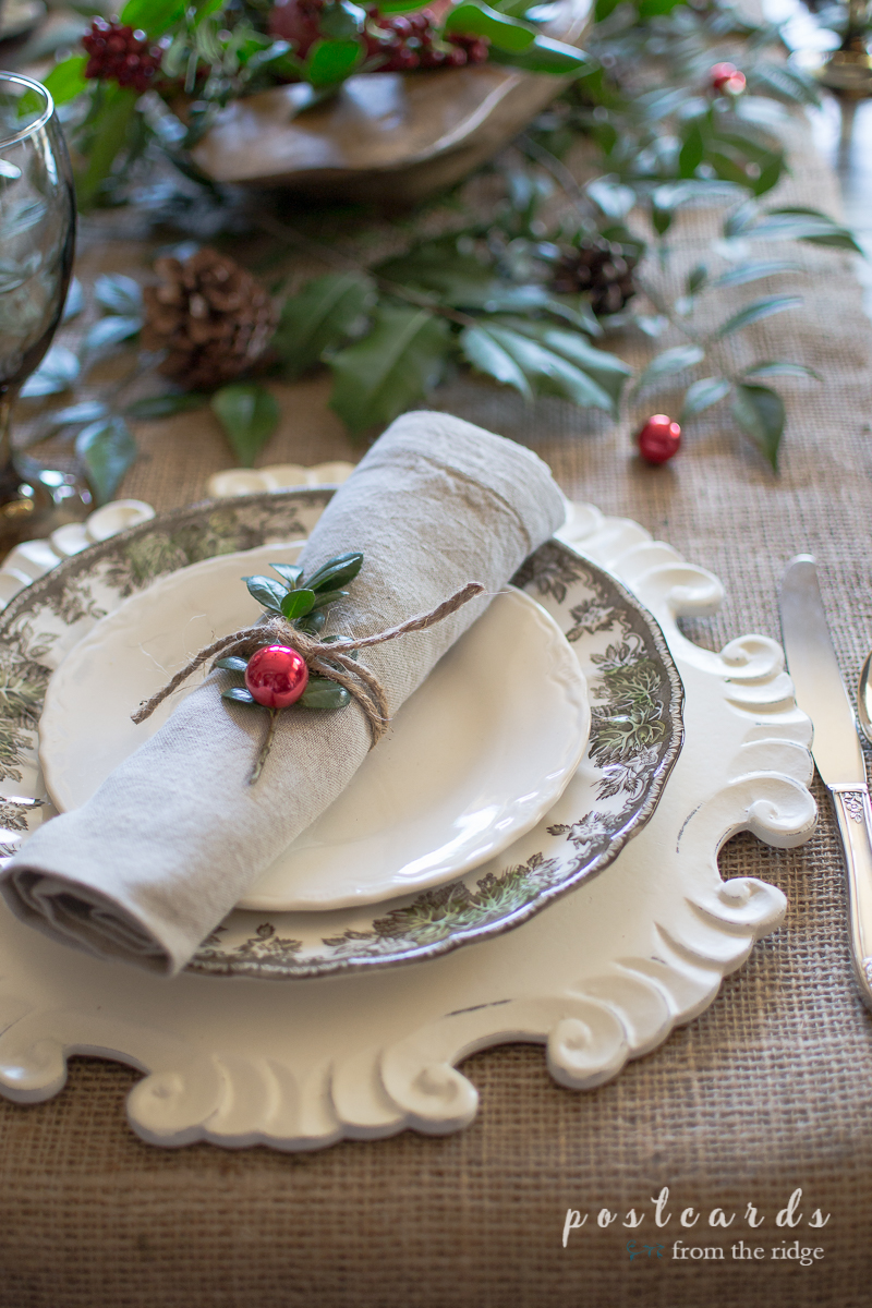 The twine and boxwood are such a sweet thing to use as a holiday napkin ring. Love this Christmas tablescape.
