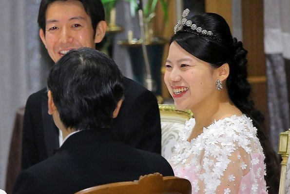 Crown Prince Naruhito and Crown Princess Masako at weeding banquet. Princess Ayako wore a pink silk dress designed by designer Norio Suzuki