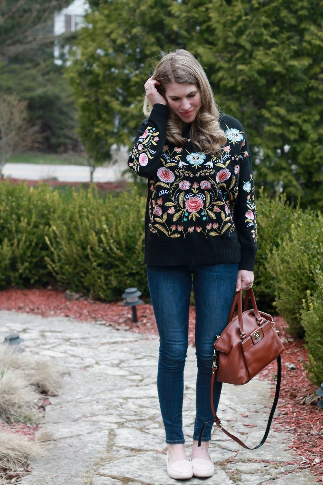 black embroidered sweater, blush loafers, blush tassel earrings, Kate Spade satchel bag