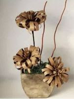 http://manualidadesparaninos.biz/flores-con-rollos-de-carton/