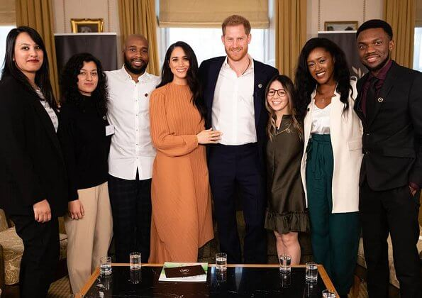 Meghan Markle wore Preen by Thornton Bregazzi Glenda asymmetric plissé georgette midi dress. Prince Harry at Buckingham Palace
