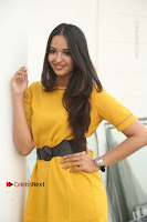 Actress Poojitha Stills in Yellow Short Dress at Darshakudu Movie Teaser Launch .COM 0131.JPG