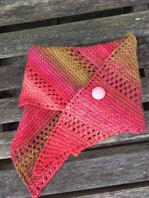 Pink, coral, and gold shawlette