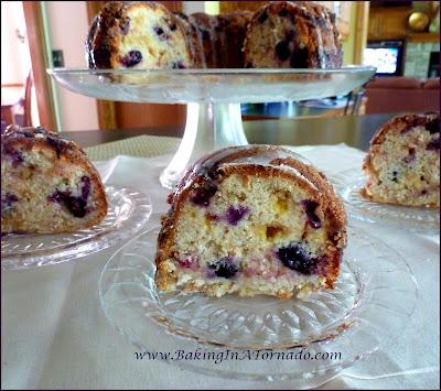 Blueberry Lemon Crunch Cake, a lucious flavorful cake made with yogurt, lemon candies and fresh blueberries. | Recipe developed by www.BakingInATornado.com | #recipe #cake