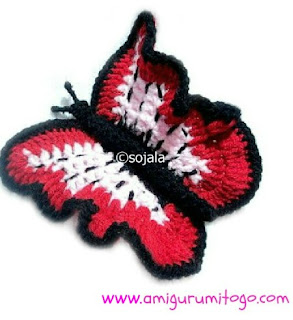 red and pink crochet butterfly with black body