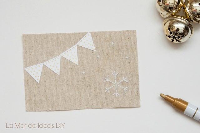 corta la cartulina para tu postal de navidad
